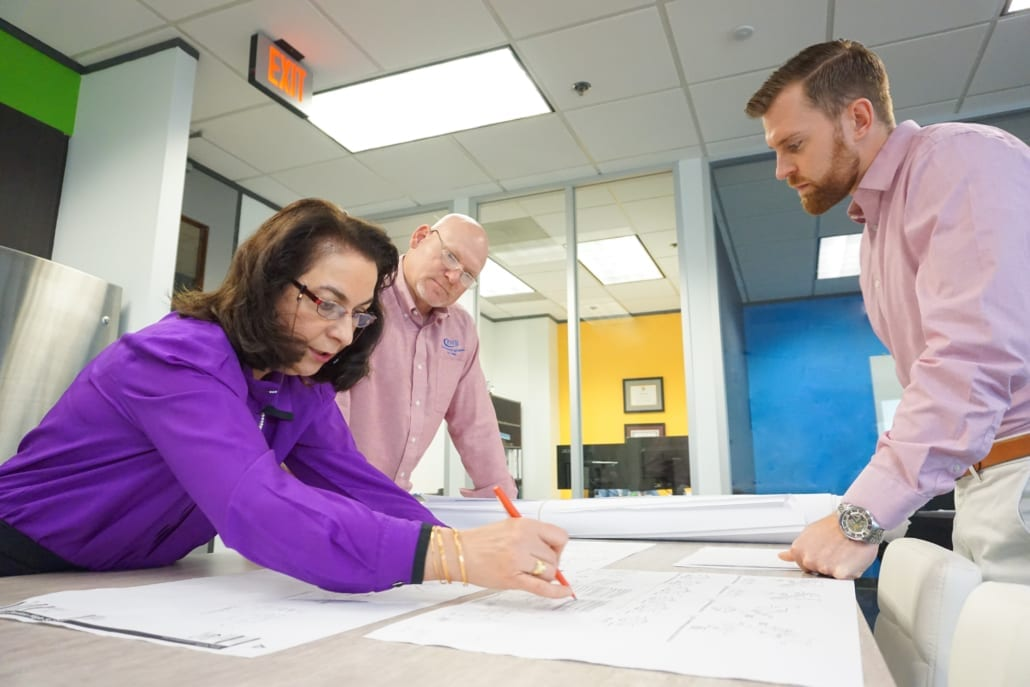 Three MEP engineers coordinate a design at RWB Consulting Engineers